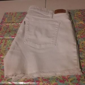 Levi's white raw hem shorts